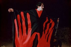 """The Master shows off his stylish vestments. Further study: See the 1966 Z-movie """"Manos: The Hands of Fate,"""" either riffed by the """"Mystery Science Theater 3000"""" gang or newly remastered by Ben Solovey."""