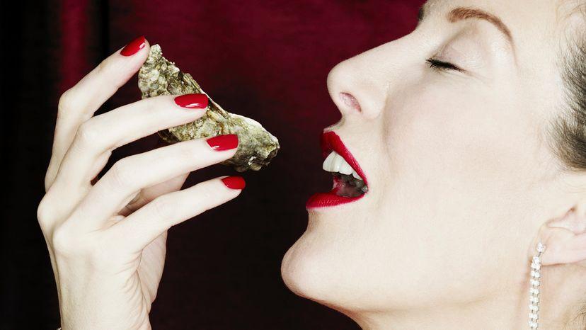 Woman Eating Oyster as an Aphrodisiac
