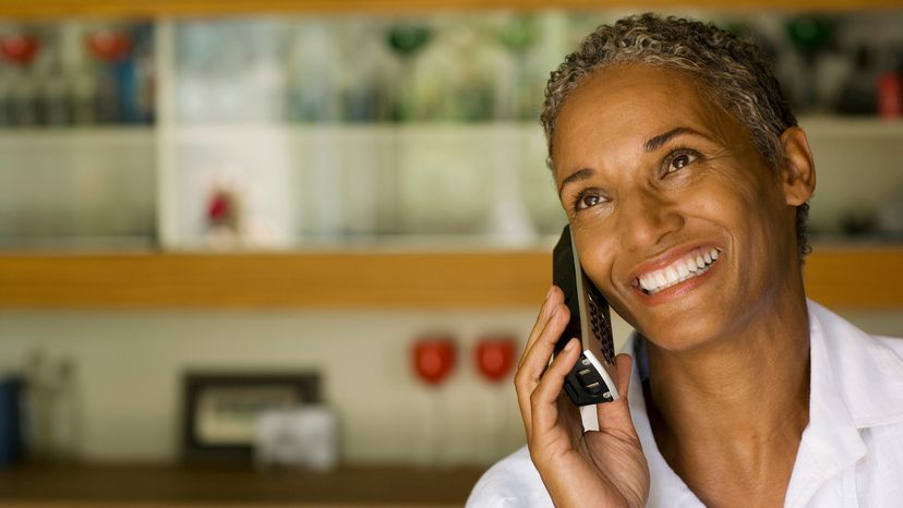 Woman holds cordless phone