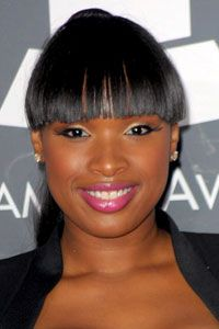 Jennifer Hudson goes mod with heavy fringe, cat eyes and bubble-gum pink lipstick and gloss.