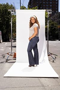 Lightly colored tops matched with dark pants flatter pear-shaped women.