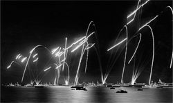The British Naval Fleet lights off flares to celebrate Elizabeth II ascending to the British throne. Not quite sure that's what Coston had in mind, guys.