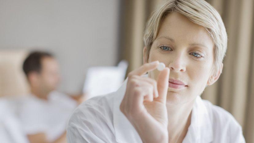 Women taking a pill