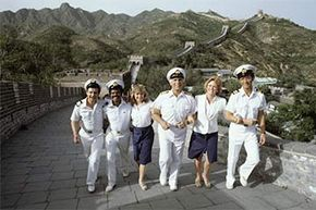 The cast of 'The Love Boat' walks along the Great Wall of China in 1983. In real life, ship workers have little time to visit their ports of call.