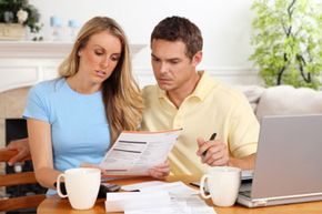 Sit down with your partner and make a plan. If you create and stick to a new budget, you may be able to swing staying home or working part-time.