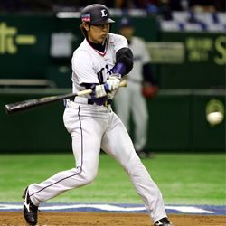 Haruki Kurose of Japan's Seibu Lions (a Pacific League team) bats in a game against China in 2009.