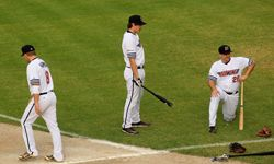 Players from the Melbourne Aces baseball team get ready for a match against the Brisbane Bandits in 2011.