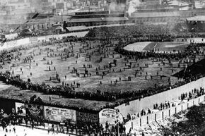 The crowd pours onto the field at Huntington Avenue Grounds in Boston following the opening game of the 1903 World Series between the Red Sox and Pittsburgh Pirates.