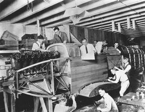 This carefully posed photo is truly history in the making, for it shows the building of the very first Douglas aircraft.