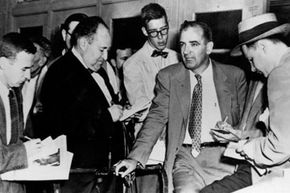 Senator Joseph McCarthy is questioned by reporters in 1953. McCarthy was famous for his investigation into alleged communist subversion.