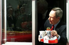McDonald's CEO Jim Skinner is seen at the drive-through window during the celebration of the chain's 50th anniversary in Chicago, 2005. Let's hope he didn't cause any emergency calls for wrong orders.