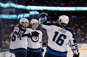 The Winnipeg Jets celebrate a win over the Tampa Bay Lightning in 2013. Looks like the irate caller's wish came true.
