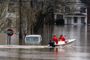 Rescue workers drive a FDNY boat past a van submerged in flood waters in New Jersey during the April 2007 nor'easter.