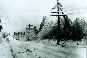 Heavy ice and snow damage telephone and telegraph lines.  Just one of the hazards of a heavy winter storm. See more storm pictures.