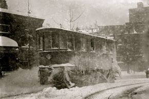 A trolley pushes through the snow and ice brought on by the Great Blizzard of 1888. This storm spurred the development of New York's subway system.
