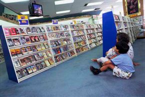 Does this bring back memories? A young boy and his mother in Mexico look at a movie inside a Blockbuster store in 1992.