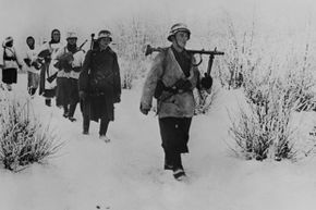 German soldiers walking through snow in the Soviet Union on Dec. 23, 1941.