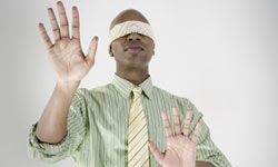 Blindfolds and groping. Never a good idea in a corporate setting.