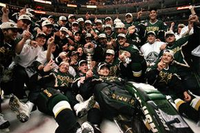 The Dallas Stars pose for a team photo with the Stanely Cup trophy as they celebrate the win over the Buffalo Sabres in 1999.