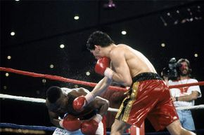 Meldrick Taylor (L) is hit with a punch from Julio Cesar Chavez during a fight at the Hilton Hotel in Las Vegas in 1990. The fight was called for Chavez with just two seconds remaining. See other sports pictures.