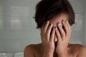 woman hiding her face in embarrassment