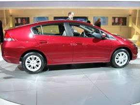 Tax incentives can help offset the cost of buying a hybrid like the Honda Insight shown here.
