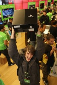 A fan in San Diego, Calif. shows off his purchase at a midnight release event.