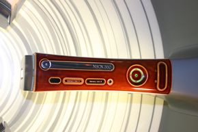 The Xbox 360 with a custom, wood-grain faceplate.