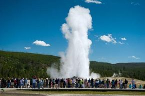 Crowds gather to witness Old Faithful's eruption at Yellowstone Park. See more national park pictures.