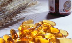 Vitamin E promotes the health of your nails, skin and hair. Some people take it orally, while others choose to break open the capsules and apply the oil topically.