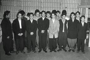 Mexican American youths in zoot suits are detained for questioning in a Los Angeles jail following a brawl during the Zoot Suit Riots.