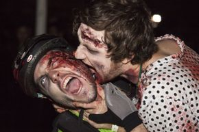 Biting is actually a pretty inefficient way to spread disease. It's especially pointless for one zombie to bite another.