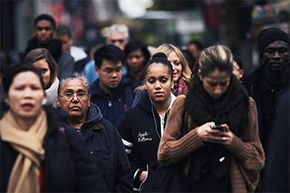 A crowd of people waits to cross the street in midtown Manhattan on Oct. 31, 2011, in New York City, the day the U.N. declared the world population had hit 7 billion.