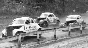 Fonty Flock, who hadn't raced since being severely injured in the summer of 1941, returned to stock car racing in 1947. Here, Flock hugs the inside rail and leads #15 Bill Snowden and #14, big brother, Bob Flock.