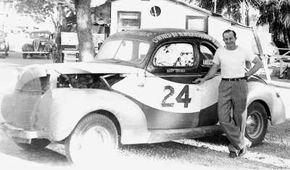 Top contending driver Buddy Shuman stands beside the 1939 Ford he ran at North Wilkesboro Speedway. The track, which opened on May 18, 1947, actually owned Shuman's car. often fielded top running cars to ensure quality cars at their races. Shuman scored his first win of one week later at Birmingham, Ala., Glenn Dunnaway in a close finish. See more pictures of NASCAR.