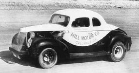 Marshall Teague drives his Hill Motor Co. #4 Ford around a track without a protective helmet. Teague was injured in a spill at North Wilkesboro and missed several races. He still accumulated enough points to rank 10th in the championship chase at the end of the 1947 NCSCC season.