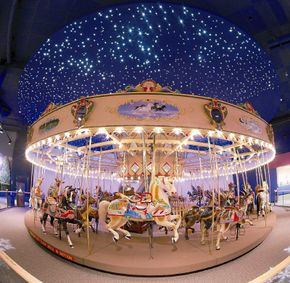 Visitors to the Children's Museum of Indianapolis can ride under a starry sky at the Carousel Wishes and Dreams Gallery.