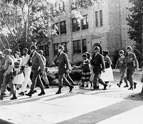 In 1957, President Eisenhower sent army troops to keep the peace during desegregation.