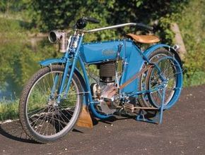 The 1910 Emblem used an enclosed coil spring to control the motions of a leading-link fork.