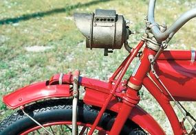 The front suspension, like the rear suspension, made use of solidly anchored leaf springs.