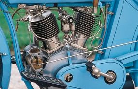The overhead intake valves were actuated through exposed pushrods and rocker arms.