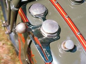 The shift-lever was placed beside the fuel tank.