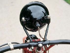 The 1926 design included a headlight and lengthened handlebars.