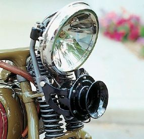 Electric headlights had largely replaced acetylene systems by 1927.