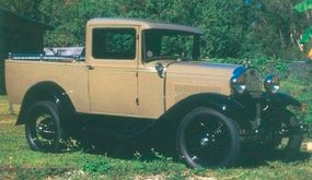 This 1931 Ford Model A Deluxe Pickup was considered rakish in its day. This example boasts a smooth-sided cargo bed with chromed railings.