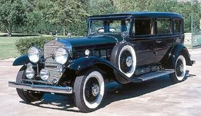 The clean lines and rounded hood of this 1931 Cadillac Sixteen Madame X sedan epitomize classic Cadillac styling.