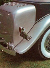 The Marmon Sixteen sported free-standing taillights, and this '32 Convertible Sedan is fitted with an add-on exterior trunk.