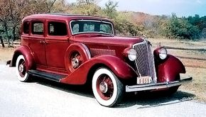 The first-series 1933 Graham Blue Streak Series 57 Eights came in coupe, convertible, and four-door sedan body styles and base and DeLuxe form. This Garnet Maroon sedan has the high-level trim, plus dual sidemounts and trunk rack.