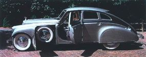 Front-fender compartments were easily large enough to secure the car's dual spare tires.