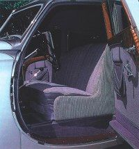 Fine broadcloth, leather, and wood lent even more elegance to the interior.